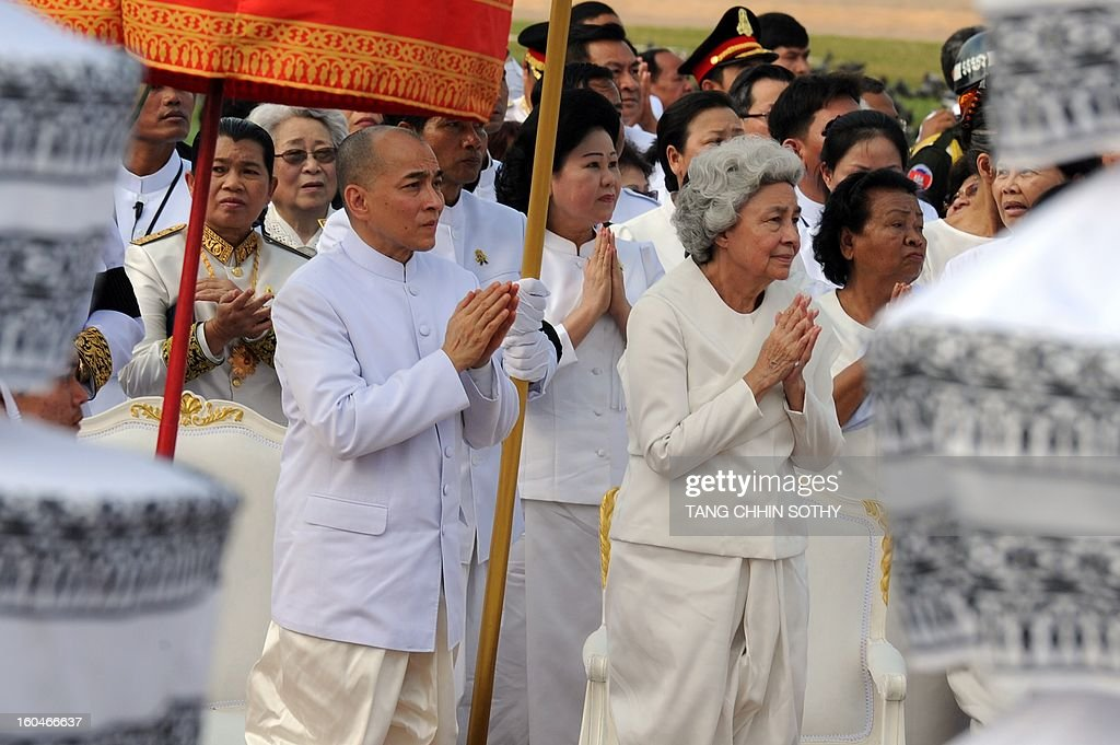Cambodian Sihanouk's widow Queen Monique (center R) and King Norodom Sihamoni (center L) pray during a funeral procession for the late former King Norodom Sihanouk in front of the Royal Palace in Phnom Penh on February 1, 2013. A sea of mourners filled the streets of the Cambodian capital on February 1 for a lavish funeral for revered former king Norodom Sihanouk, who towered over six tumultuous decades in his nation's history.