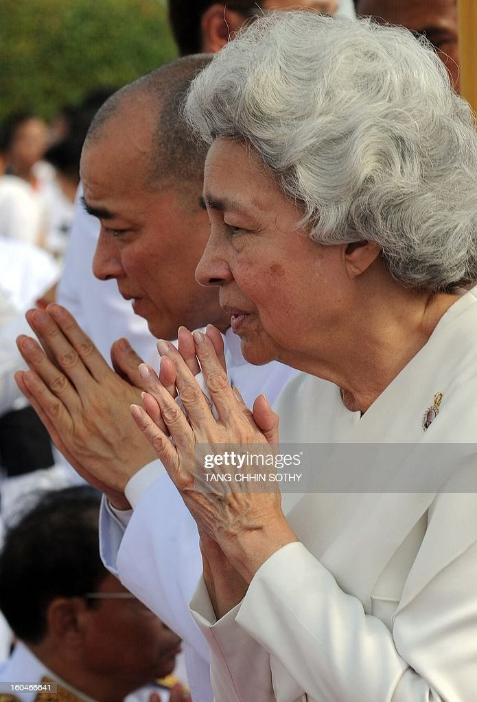 Cambodian Sihanouk's widow Queen Monique (R) and King Norodom Sihamoni (L) greet government officials during a funeral procession for the late former King Norodom Sihanouk in front of the Royal Palace in Phnom Penh on February 1, 2013. A sea of mourners filled the streets of the Cambodian capital on February 1 for a lavish funeral for revered former king Norodom Sihanouk, who towered over six tumultuous decades in his nation's history.