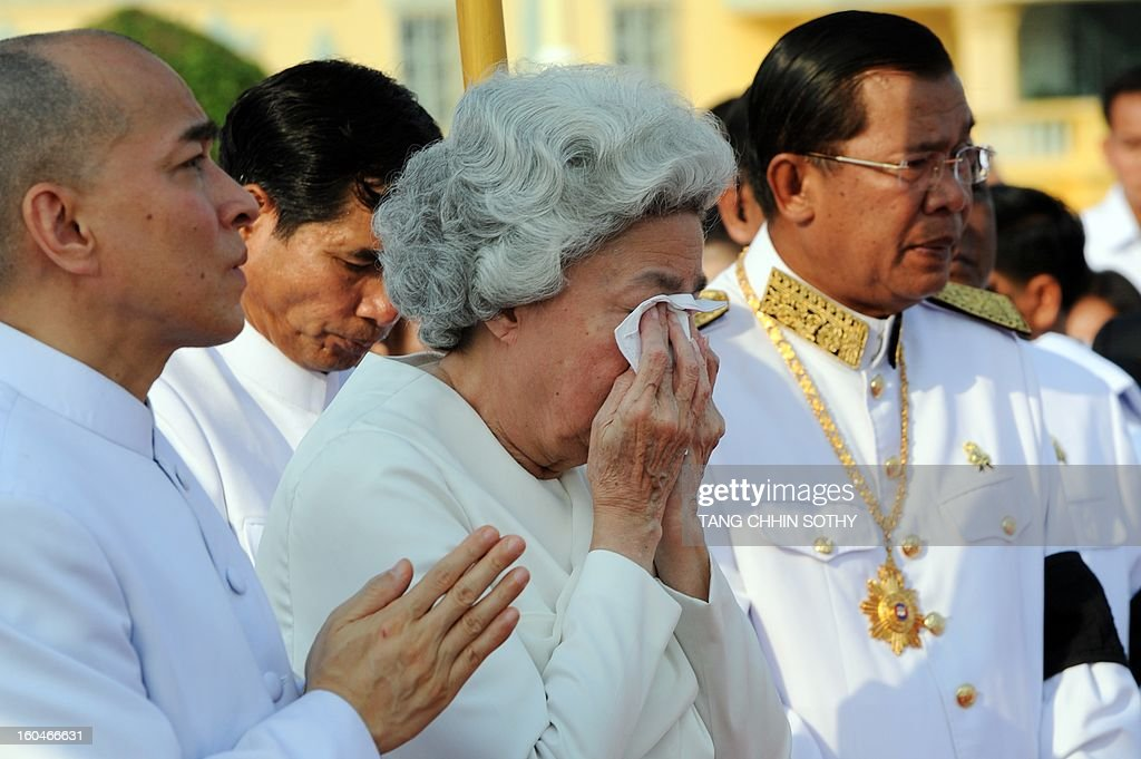 Cambodian Sihanouk's widow Queen Monique (C), King Norodom Sihamoni (L) and Prime Minister Hun Sen (R) react during a funeral procession for the late former King Norodom Sihanouk in front of the Royal Palace in Phnom Penh on February 1, 2013. A sea of mourners filled the streets of the Cambodian capital on February 1 for a lavish funeral for revered former king Norodom Sihanouk, who towered over six tumultuous decades in his nation's history.