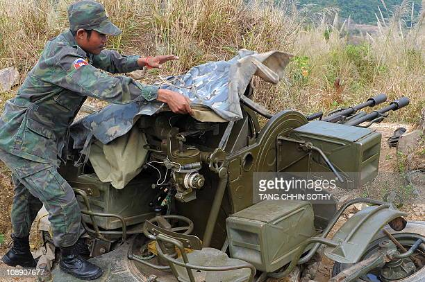 A Cambodian soldier covers a antiaircraft gun system at a position near the Preah Vihear temple in Preah Vihear province some 500km north of Phnom...