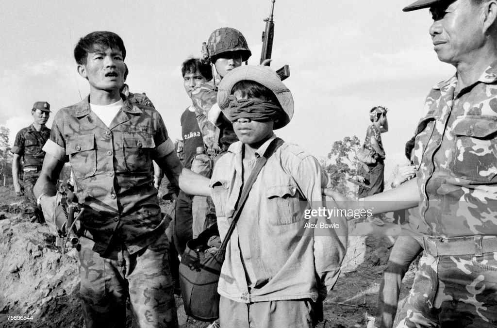 A Cambodian soldier fighting alongside Vietnamese forces against the Khmer resistance is captured by the Thai military south of Aranyaprathet during fighting that spilt over into Thailand, 10th March 1985. In the 1984 to 1985 Vietnamese dry-season offensive, the Khmer resistance reportedly lost nearly a third of its 12,000 to 15,000 troops in battle and through desertions.