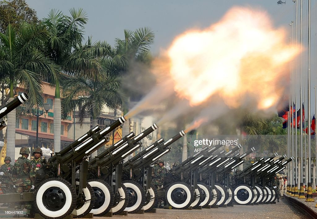 Cambodian soldiers fire artilleries during a funeral procession in front of the Royal Palace in Phnom Penh on February 1, 2013. Sihanouk, who abdicated in 2004 after steering Cambodia through six decades marked by independence from France, civil war, the murderous Khmer Rouge regime and finally peace, died of a heart attack in Beijing on October 15, 2012 and will be cremated on February 4.