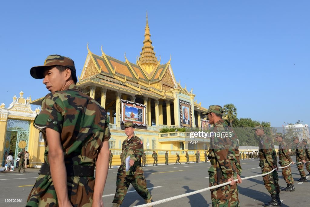 Cambodian soldiers stand during a funeral march procession rehearsal for the late former King Norodom Sihanouk in front of the Royal Palace in Phnom Penh on January 19, 2013. Cambodia's beloved former monarch Norodom Sihanouk, who died aged 89 last month, will be cremated on February 4 following an elaborate ceremony, Cambodian Prime Minister Hun Sen said on November 26, 2012. AFP PHOTO/ TANG CHHIN SOTHY