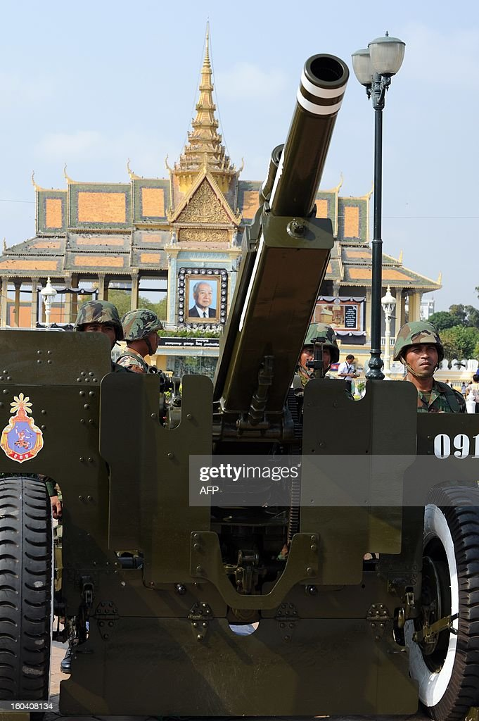 Cambodian soldiers stand near an artillery during a funeral procession rehearsal for the late former King Norodom Sihanouk in front of the Royal Palace in Phnom Penh on January 31, 2013. Sihanouk, who abdicated in 2004 after steering Cambodia through six decades marked by independence from France, civil war, the murderous Khmer Rouge regime and finally peace, died of a heart attack in Beijing on October 15, 2012 and will be cremated on February 4.