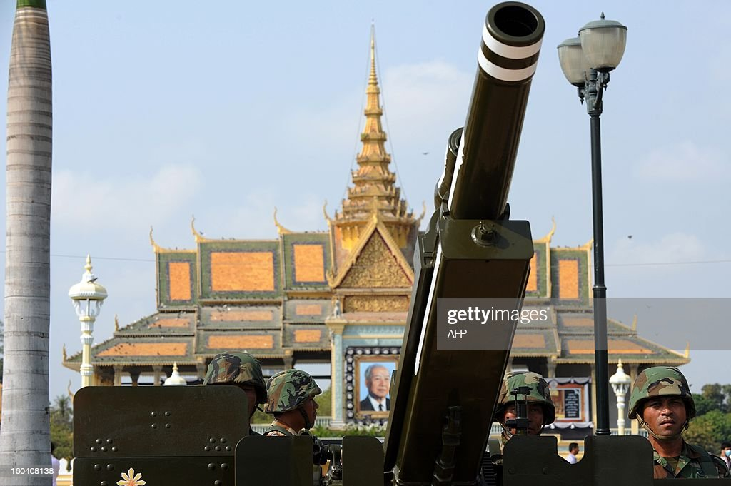 Cambodian soldiers stand near an artillery during a funeral procession rehearsal for the late former King Norodom Sihanouk in front of the Royal Palace in Phnom Penh on January 31, 2013. Sihanouk, who abdicated in 2004 after steering Cambodia through six decades marked by independence from France, civil war, the murderous Khmer Rouge regime and finally peace, died of a heart attack in Beijing on October 15, 2012 and will be cremated on February 4. AFP PHOTO / TANG CHHIN SOTHY