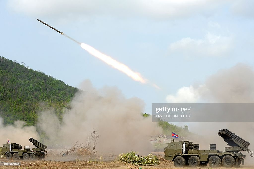 Cambodian soldiers test fire a multiple rocket launcher (BM21) at a military base in Kampong speu province, some 70 kilometers west of Phnom Penh on April 2, 2013. Cambodia's military drill of multiple rockets launchers (BM21) and artillery 130-mm on April 2, is aimed at strengthening its national defence ability. AFP PHOTO/TANG CHHIN SOTHY
