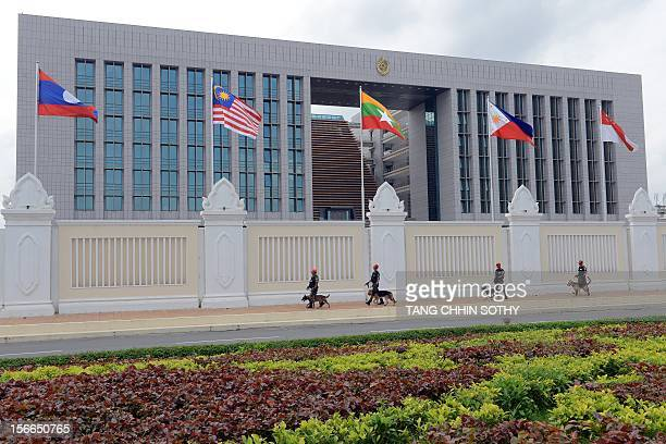 Cambodian soldiers walk with sniffer dogs as the secure the area in front of the Peace Palace building in Phnom Penh on November 18 2012 as the...