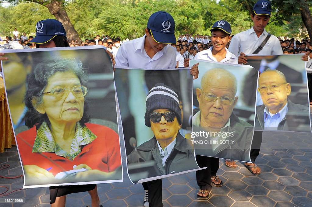 Cambodian students hold portrait photos of former Khmer Rouge leaders, ex-social affairs minister Ieng Thirith (L), former Khmer Rouge leader 'Brother Number Two' <a gi-track='captionPersonalityLinkClicked' href=/galleries/search?phrase=Nuon+Chea&family=editorial&specificpeople=767256 ng-click='$event.stopPropagation()'>Nuon Chea</a> (2nd L), former Khmer Rouge leader head of state <a gi-track='captionPersonalityLinkClicked' href=/galleries/search?phrase=Khieu+Samphan&family=editorial&specificpeople=769531 ng-click='$event.stopPropagation()'>Khieu Samphan</a> (2nd R) and former Khmer Rouge deputy prime minister and minister of foreign affairs Ieng Sary (R), during an outreach programme at a school in Phnom Penh on November 18, 2011. Prosecutors at Cambodia's Khmer Rouge tribunal are expected to decide on November 18 whether to appeal against a decision to release a genocide suspect deemed unfit for trial because she has dementia.