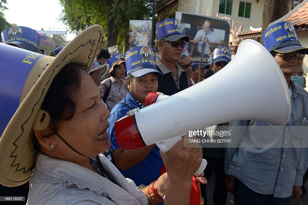 Cambodian supporters of Mam Sonando (C), owner of the independent Beehive radio station, shout slogans in front of the Appeal court in Phnom Penh on March 5, 2013. A prominent critic of Cambodia's government, sentenced to 20 years in prison for an alleged secessionist plot, on March 5, pleaded not guilty during his appeal hearing.