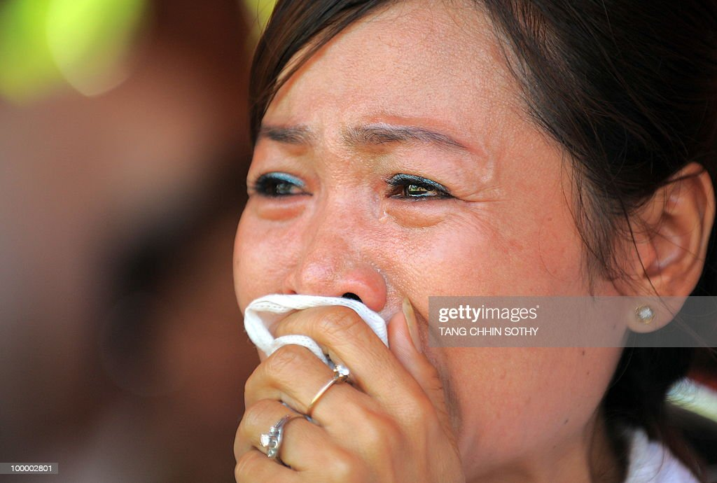 A Cambodian woman reacts during the annu