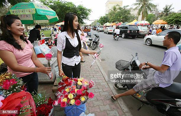 Cambodian woman sell Valentine's day flowers along a street in Phnom Penh on February 14 2009 Valentine's Day or Saint Valentine's Day is celebrated...
