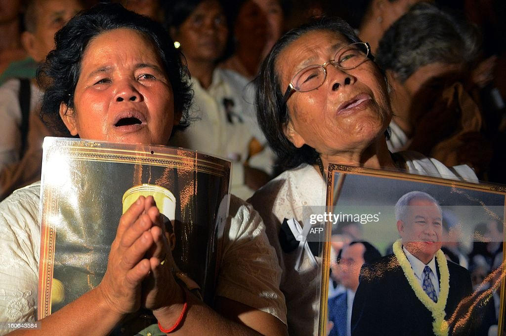 Cambodian women cry during the cremation of Cambodia's King Norodom Sihanouk near the Royal Palace in Phnom Penh on February 4, 2013. Thousands of mourners massed in the Cambodian capital as the kingdom cremated its revered former King Sihanouk, who steered his country through six turbulent decades.