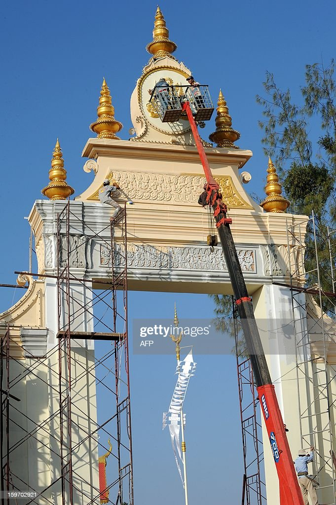 Cambodian workerd paint a main gate at a construction site being prepared for the forthcoming cremation ceremony of the late former King Norodom Sihanouk, near the Royal Palace in Phnom Penh on January 19, 2013. Cambodia's beloved former monarch Norodom Sihanouk, who died aged 89 last month, will be cremated on February 4 following an elaborate ceremony, Cambodian Prime Minister Hun Sen said on November 26, 2012.