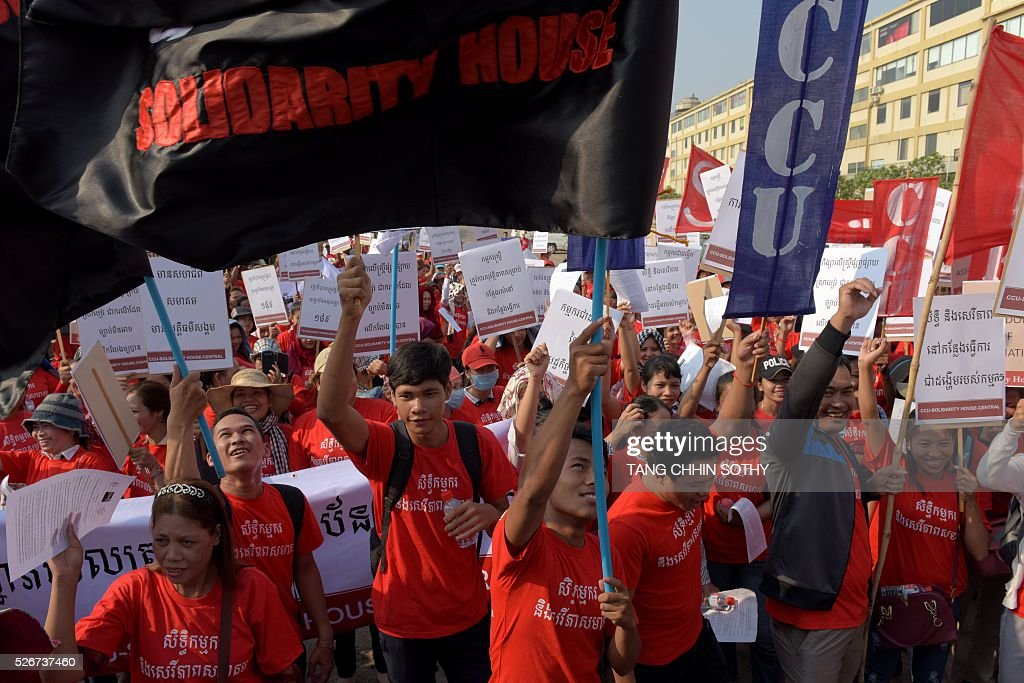 Cambodian workers hold placards and banners as they shout slogans to mark May Day, or International Workers Day, in Phnom Penh on May 1, 2016. Activists around the world mark May Day with marches demanding better working conditions, more jobs and higher wages. / AFP / TANG