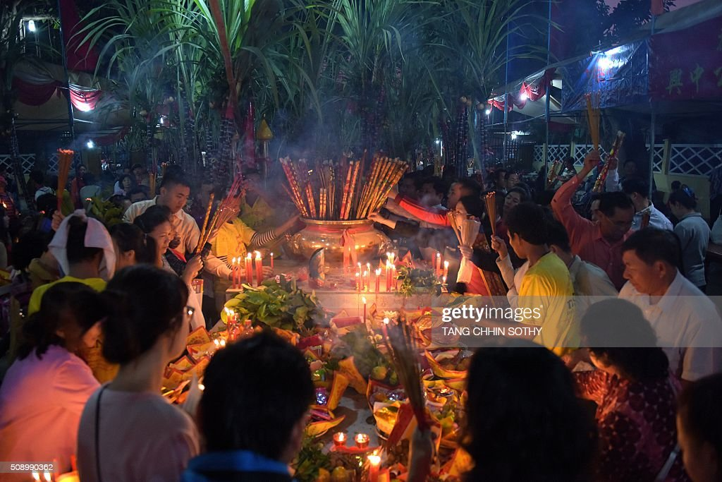 Cambodian-Chinese pray at a temple to mark the start of the Lunar New Year in Kandal province on February 8, 2016. While not a holiday in Cambodia, the Lunar New Year, the most important holiday in China and a number of countries in east and southeast Asia, started on February 8 bringing in the 'Year of the Monkey'. AFP PHOTO / TANG CHHIN SOTHY / AFP / TANG CHHIN SOTHY