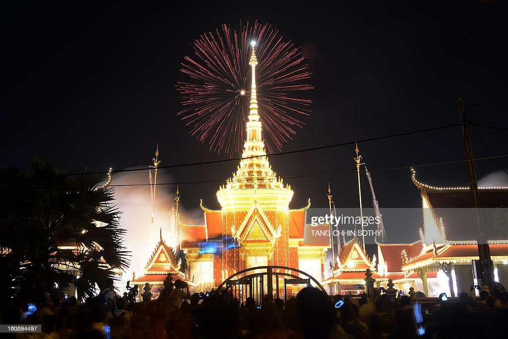 Cambodians gather to watch fireworks at the cremation site for the late former King Norodom Sihanouk near the Royal Palace in Phnom Penh on February 3, 2013. Thousands of Cambodians have paid their last respects to their beloved former king Norodom Sihanouk as his body lay in state ahead of his cremation on February 4.