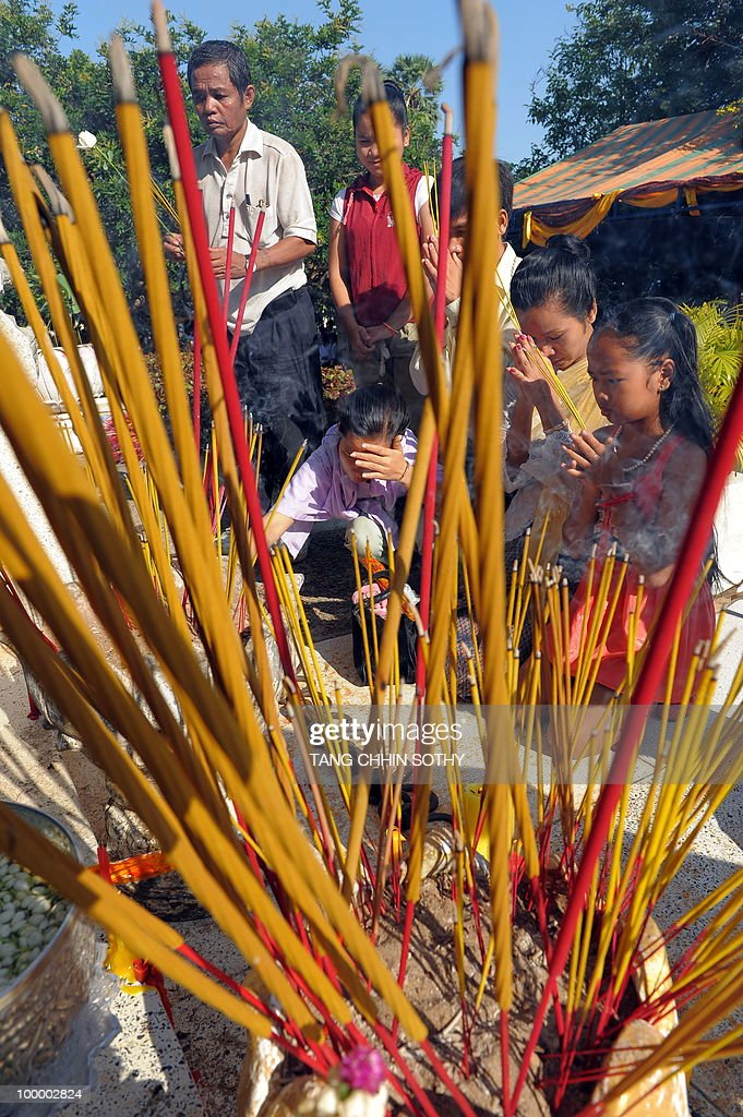 Cambodians pray during the annual 'Day of Anger' at the Choeung Ek killing fields memorial near Phnom Penh on May 20, 2010. Tearful Cambodians marked an annual 'Day of Anger' with a re-enactment of Khmer Rouge crimes at a notorious 'killing field' on May 20, to commemorate their relatives killed by the ruthless regime.
