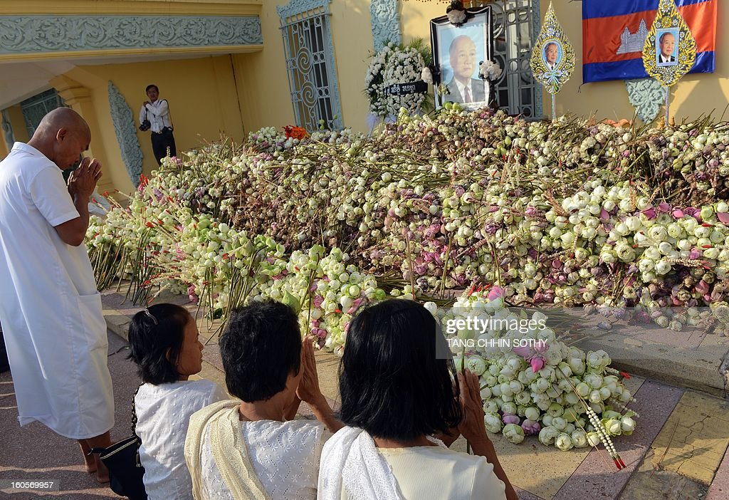 Cambodians pray for their late former king Norodom Sihanouk in front of the Royal Palace in Phnom Penh on February 3, 2013. Thousands of Cambodians have paid their last respects to their beloved former king Norodom Sihanouk as his body lay in state ahead of his cremation on February 4.