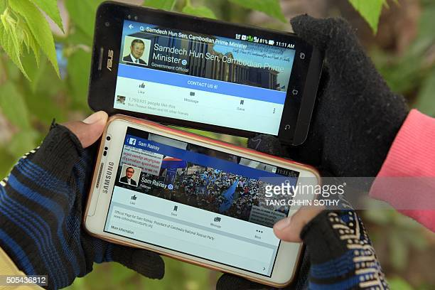 CambodiapoliticsInternetmassmedia FEATURE by SUY This photo taken on January 8 2016 shows Cambodian people holding their mobile phones displaying...