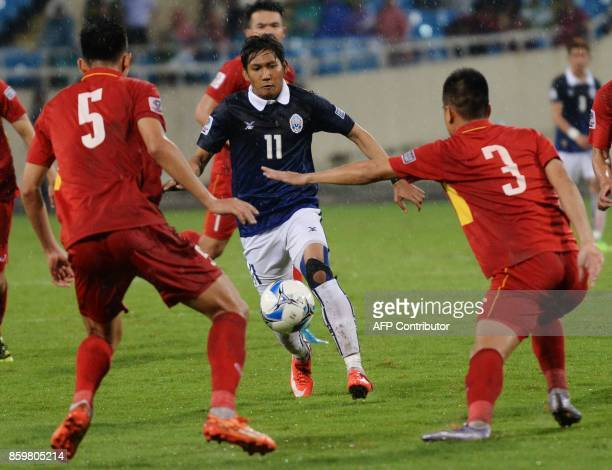 Cambodia's Chan Vathanaka leads an attack during the AFC Asian 2019 Cup qualifier against Vietnam at Hanoi's My Dinh stadium on October 10 2017...