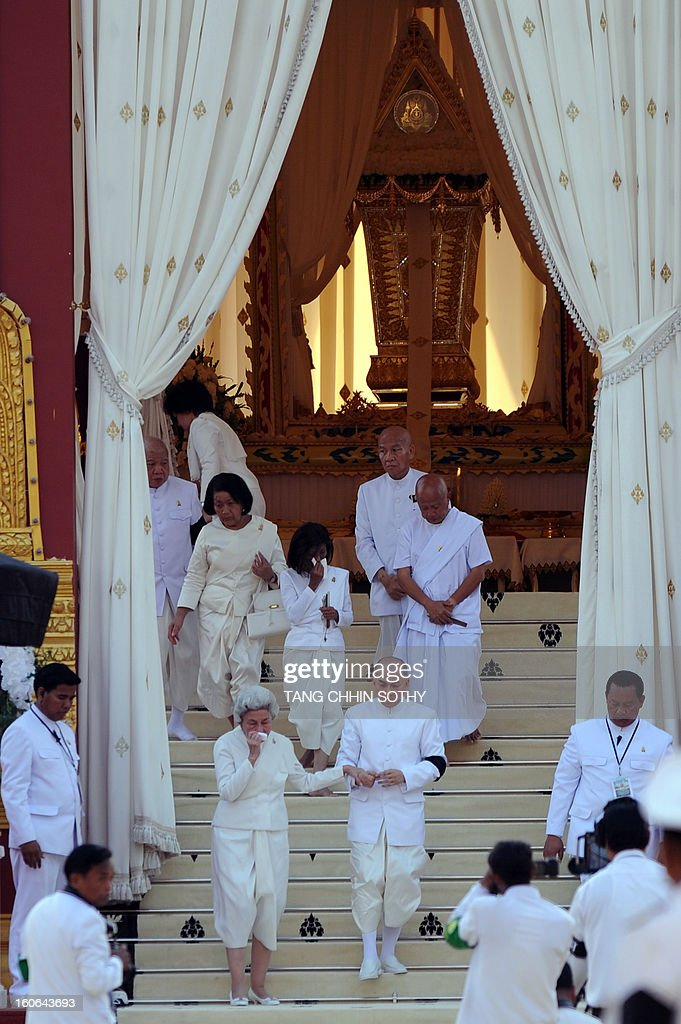 Cambodia's King Norodom Sihamoni (centre R) and Queen Monineath (centre L) walk down the staircase during the cremation of Cambodia's King Norodom Sihanouk near the Royal Palace in Phnom Penh on February 4, 2013. Thousands of mourners massed in the Cambodian capital as the kingdom cremated its revered former King Norodom Sihanouk, who steered his country through six turbulent decades. AFP PHOTO/ TANG CHHIN SOTHY