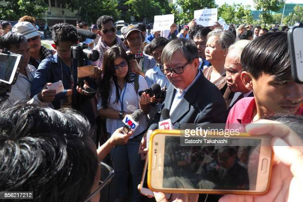 Cambodia's main opposition Cambodia National Rescue Party lawmaker Son Chhay speaks to the media during a protest demanding the release of CNRP...
