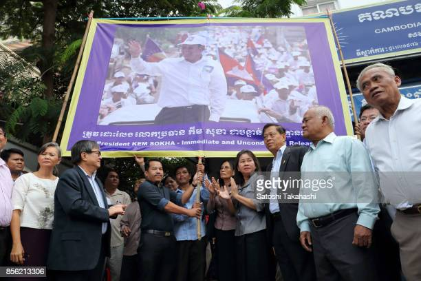 Cambodia's main opposition Cambodia National Rescue Party members set up a banner calling for the release of CNRP President Kem Sokha during a press...