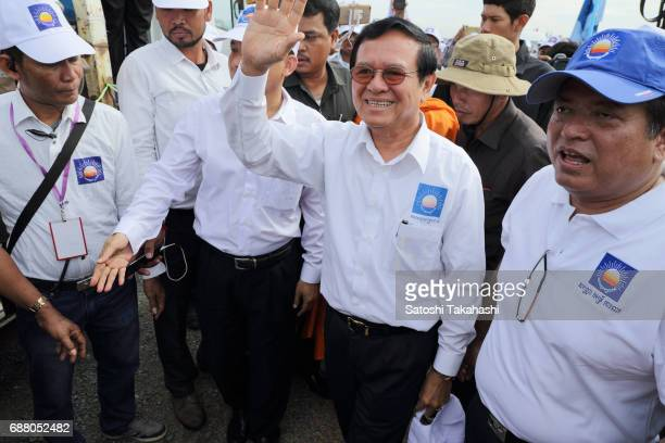 Cambodia's main opposition Cambodia National Rescue Party President Kem Sokha greets CNRP supporters during a rally on the first day of campaigning...