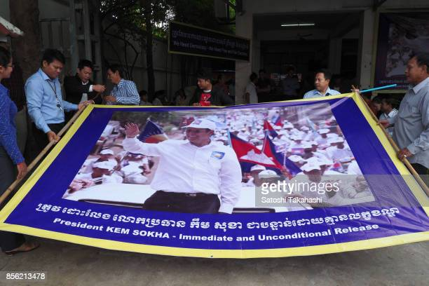 Cambodia's main opposition Cambodia National Rescue Party supporters prepare a banner calling for the release of CNRP President Kem Sokha at the...