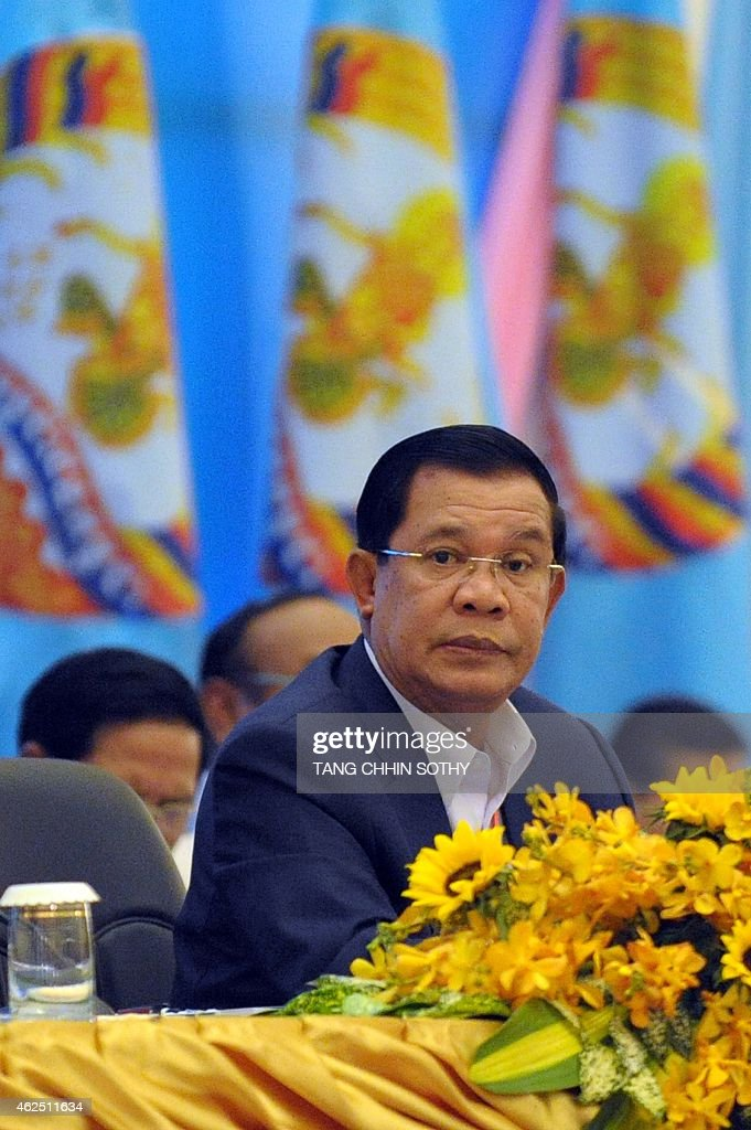 Cambodia's Prime Minister <a gi-track='captionPersonalityLinkClicked' href=/galleries/search?phrase=Hun+Sen&family=editorial&specificpeople=224084 ng-click='$event.stopPropagation()'>Hun Sen</a> attends the start of the two-and-a-half-day ruling Cambodian People's Party (CCP) congress in Phnom Penh on January 30, 2015. <a gi-track='captionPersonalityLinkClicked' href=/galleries/search?phrase=Hun+Sen&family=editorial&specificpeople=224084 ng-click='$event.stopPropagation()'>Hun Sen</a>, 62, who marked three decades as premier earlier this month, has previously vowed to stay in power until he is 74.