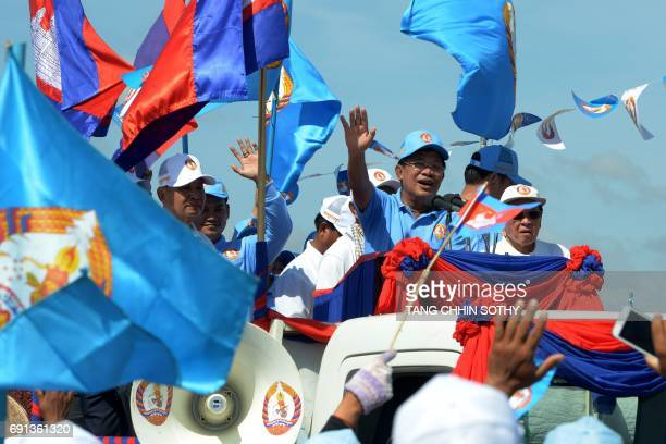Cambodia's Prime Minister Hun Sen greets supporters of the Cambodian People's Party during the last day of the commune election campaign in Phnom...