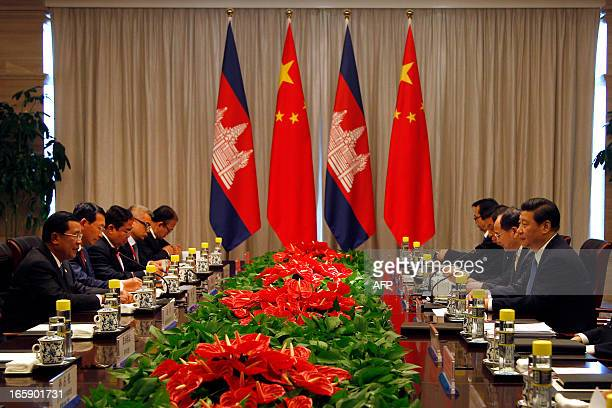 Cambodia's Prime Minister Hun Sen speaks during a meeting with China's President Xi Jinping on the sidelines of the Boao Forum for Asia in Boao on...