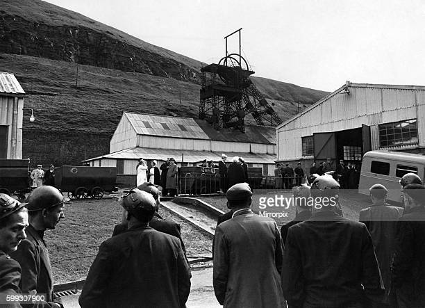 Cambrian Colliery Disaster at Tonypandy Miners stand at the pit head end as ambulance waits at the Shaft entrance May 1965 P004436