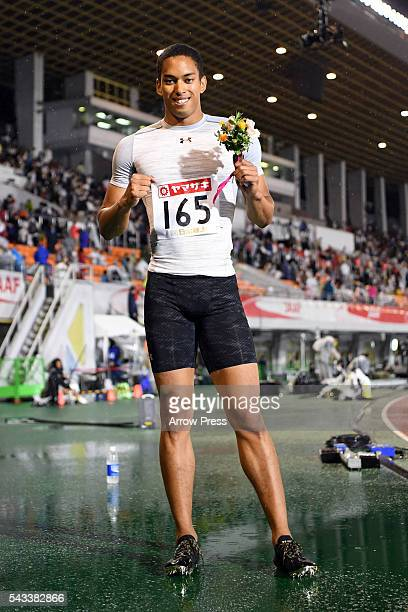 Cambridge Aska Antonio of Japan pose with the after winning the competes in Men's 100m Final during the 100th Japan National Athletic Championships...