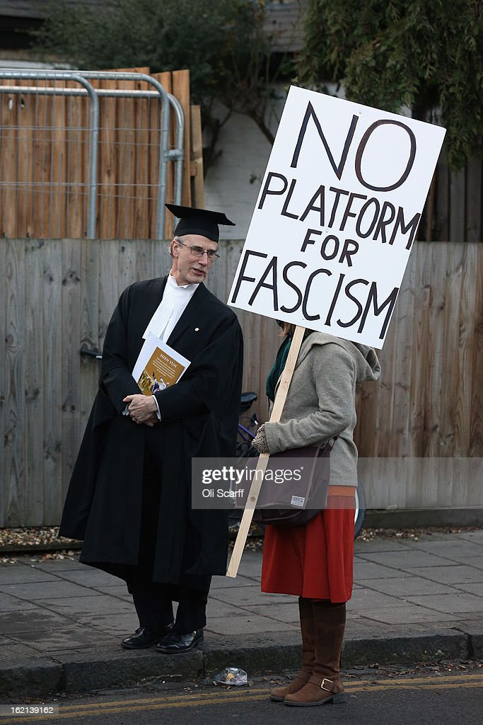 A Cambridge proctor speaks to a protester as she and others gather outside Cambridge University's Student Union as Marine Le Pen, the leader of the French far-right 'Front National' party, addresses the Union's debating society on February 19, 2013 in Cambridge, England. Mrs Le Pen, who has been an MEP since 2004 and is the daughter of former Front National leader Jean Marie Le Pen, is expected to speak about the future of the European Union and French politics. Although her appearance at the Union has provoked controversy with the anti-fascist group 'Unite Against Fascism'.