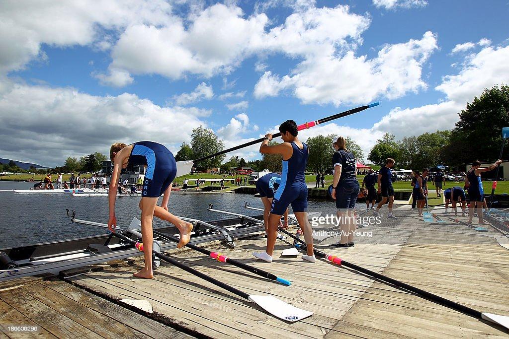 Cambridge R.C crew members prepare their race during the Te Awamutu Rowing Clubs Annual Club Regatta at Lake Karapiro on November 2, 2013 in Karapiro, New Zealand.