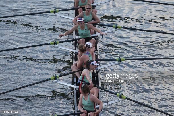 TOPSHOT Cambridge rowers Claire Lambe Anna Dawson Holly Hill Alice White Myriam Goudet and Melissa Wilson celebrate winning the annual women's boat...