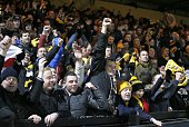 Cambridge United fans celebrate after a 00 tie at the end of the FA Cup fourth round football match between Cambridge United and Manchester United at...