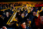 Cambridge United fans celebrate after the FA Cup Fourth Round match between Cambridge United and Manchester United at The R Costings Abbey Stadium on...