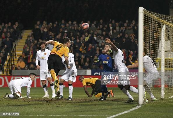 Cambridge United's English defender Josh Coulson head unsuccessfully at goal from a corner during the FA Cup fourth round football match between...