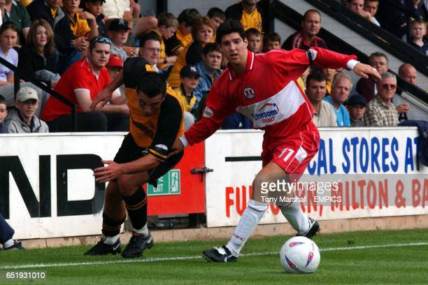 Cambridge United's Shane Tudor is disowned by Leyton Orient's Matthew Brazier