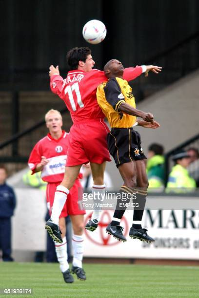 Cambridge United's Terry Fleming and Leyton Orient's Matthew Brazier jump for the ball