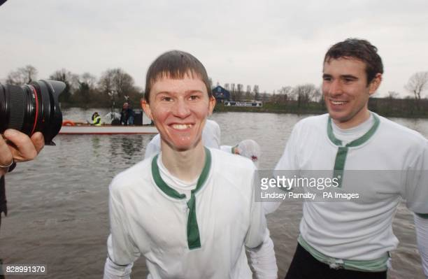 Cambridge University's Coxwain Kenelm Richardson emerges wet after being thrownin to the river by teammates after winning the 150th Boat Race between...