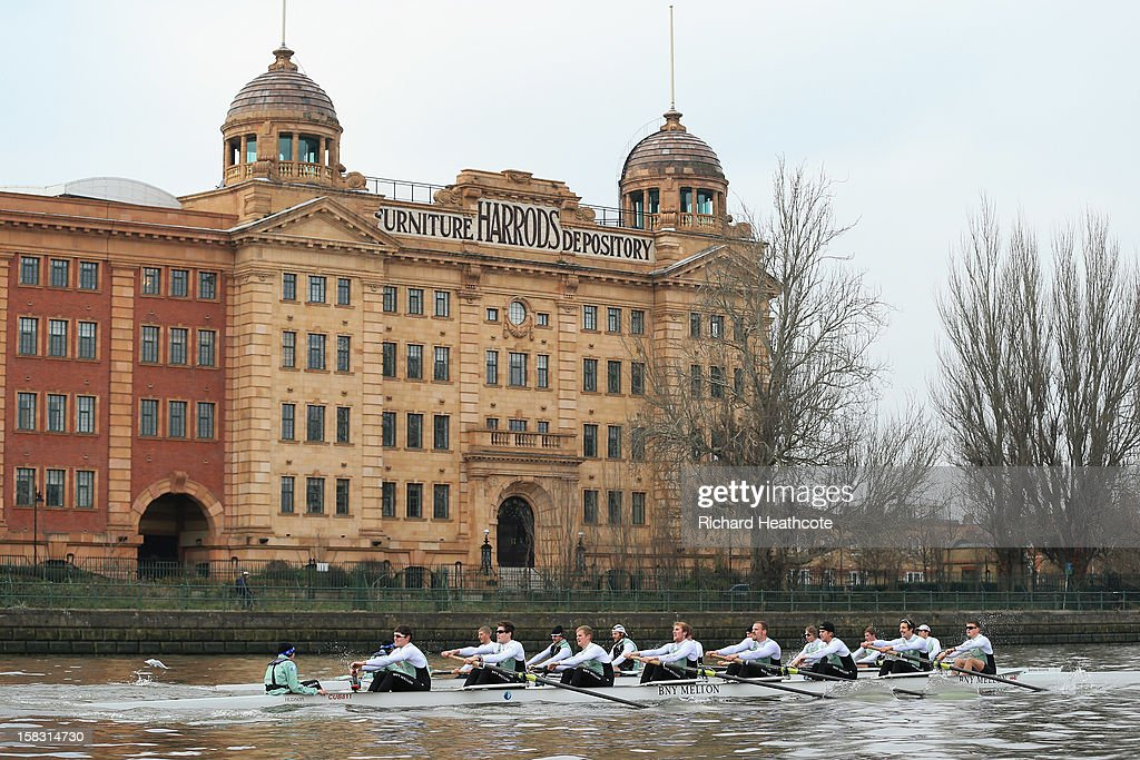 Cambridge's 'Bangers' and 'Mash' crews pass the Harrod's Depository during the trial 8's for The BNY Melon University Boat Race on The River Thames on December 13, 2012 in London, England.