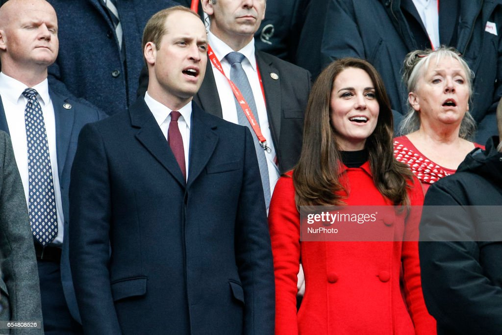 Cambridge's Duke and duchess Prince William and Kate Middleton sing the national anthem ahead of the Six Nations tournament Rugby Union match between France and Wales at the Stade de France in Saint-Denis, outside Paris, on March 18, 2017.