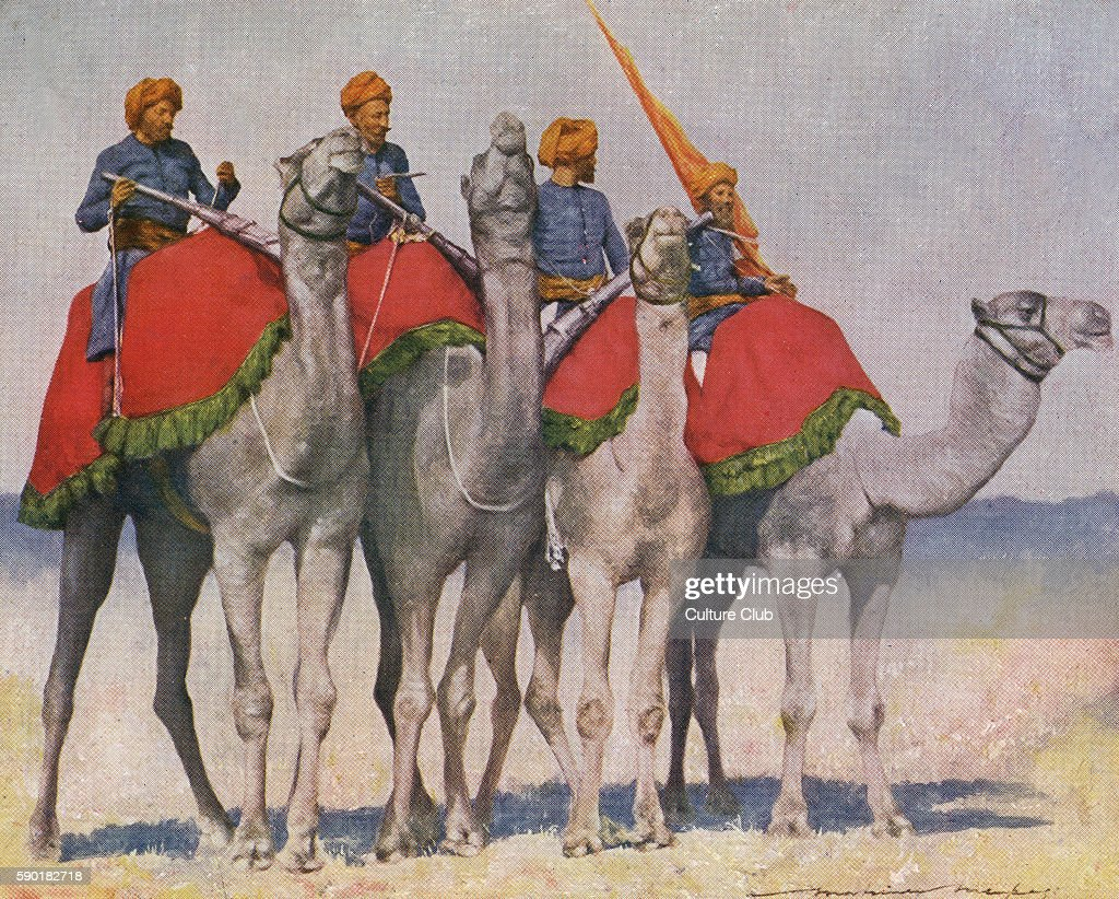 Camel cavalry / Camelry from Alwar India Soldiers wearing a uniform of blue collarless jackets and orange turbans sit atop camels caption reads '...
