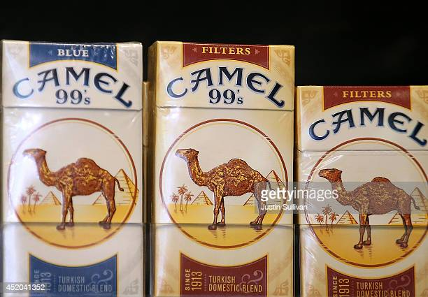 Camel cigarettes manufactured by Reynolds Amercian are displayed at a tobacco shop on July 11 2014 in San Francisco California Tobacco giant Reynolds...