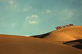 Camel crew in desert, Badain Jaran Desert ,China