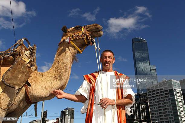 Camel handler Philip Jones leads his camels Tinkerbell and Jake from Melbourne's Hamer Hall along Southbank Promenade to the Immigration Museum...