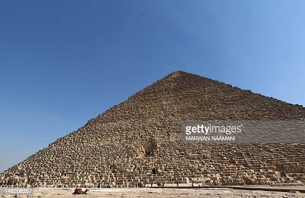 A camel is seen resting in front of the Great Pyramid of Giza or the Pyramid of Cheops that is deserted of foreign tourits at alGiza south of Cairo...